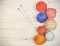 Vintage toned yarn balls on wooden boards. Royalty Free Stock Photo