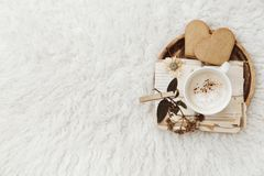 Vintage toning background with old paper, coffee, and dry flowers. stock image
