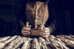 Vintage tools background. Detail of hands holding vintage hand planer royalty free stock photo