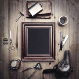 Vintage tools of a barber with picture frame Royalty Free Stock Photo