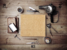 Vintage tools of barber shop with blank kraft poster Stock Photos