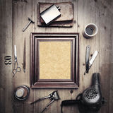 Vintage tools of barber shop with canvas in picture frame Royalty Free Stock Photos