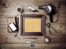 Vintage tools of barber shop with picture frame Royalty Free Stock Photography