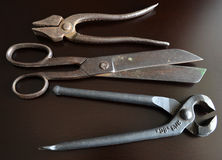 Vintage tools. On a dark background Stock Photos