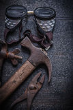 Vintage tools  hammer pliers goggles clamp Royalty Free Stock Image