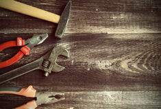 Vintage tools. Hand tools at the old wooden background. Vintage background with tools Royalty Free Stock Photography