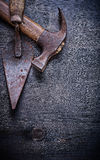 Vintage tools putty knife claw hammer on wood board Stock Images