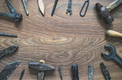 Vintage tools on wooden background. Fathers day card. Different tools (pliers, hammer, wrench, nippers, chisel, rasp, screwdriver, drill) on a wooden background Royalty Free Stock Image