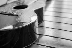 Vintage top guitar on old wood surface. Royalty Free Stock Images