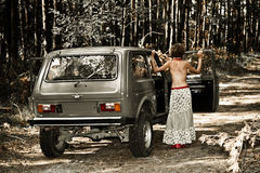 Vintage topless girl in front of the car Stock Photography