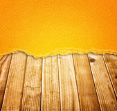 Vintage torn paper over wood planks background. warm tone. Royalty Free Stock Photo