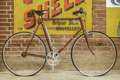 Vintage touring bicycle in front of old advertising placards Royalty Free Stock Photography