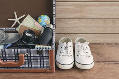 Vintage tourist luggage with clothes, accessories Royalty Free Stock Images