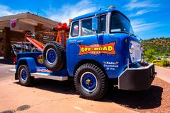 Vintage Tow Truck. Sedona, Arizona USA - May 2, 2017: Vintage colorful 1959 tow truck parked along highway 89 in this popular small tourist town Royalty Free Stock Images
