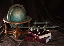 Vintage Toy Airplane with Globe and Books royalty free stock photography