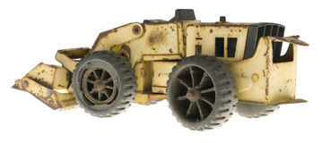Vintage Toy Bulldozer. Abandoned vintage toy bulldozer on pure white background, side view Stock Photography