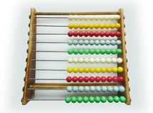 Vintage toy calculator. A 40' calculator, mulicoloured beads and wooden supports Stock Photos
