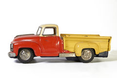 Vintage toy car. Worn red orange yellow Royalty Free Stock Images