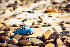 Vintage Toy Car on the beach. Travel and adventure concept Royalty Free Stock Photo