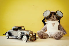 Vintage toy car and cute teddy bear Stock Images