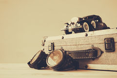 vintage toy car and old suitcase next to pilot glasses Royalty Free Stock Images
