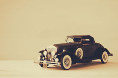 Vintage toy car over wooden table Stock Photos