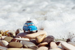 Vintage toy car parked near the sea. Travel concept Royalty Free Stock Photos