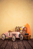 Vintage toy car and suitcase Royalty Free Stock Image