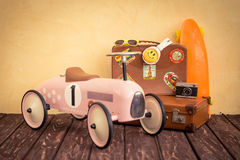 Vintage toy car and suitcase Stock Image