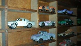 Vintage toy cars. In a custom vintage printer press drawer shelf Royalty Free Stock Photos