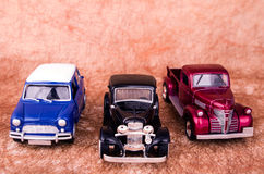 Vintage toy cars in an old background Royalty Free Stock Image