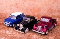 Vintage toy cars in an old background. Vintage toy cars in white background Royalty Free Stock Image