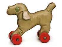 Vintage toy dog. With red wheels on white background Stock Photo