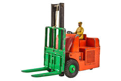 Vintage toy fork lift truck isolated on white Royalty Free Stock Images