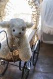 Vintage Toy lamb in carriage. Vintage children's Toy lamb in carriage stock photography