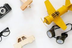 vintage toy plane, old photo camera and pilot glasses Stock Photography