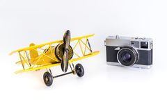 Vintage toy plane with vintage travel camera isolated on white travel concept royalty free stock photo