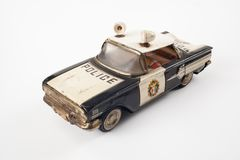 Vintage toy police car. Isolated on white royalty free stock photography