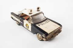 Vintage toy police car. Isolated on white stock images