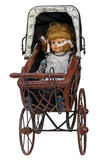 Vintage toy pram with doll Royalty Free Stock Images
