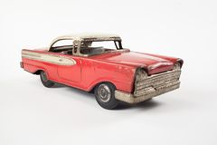 Vintage toy red metal car. Isolated on white stock image