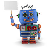 Vintage toy robot with sign. Vintage toy robot smiling and holding up a sign Royalty Free Stock Image