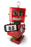 Vintage toy robot with smartphone vector illustration