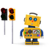 Vintage toy robot stopping at traffic light Royalty Free Stock Image