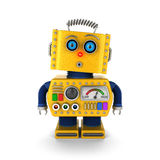 Vintage toy robot with surprised facial expression. Cute yellow vintage toy robot with a surprised facial expression over white background Stock Photo