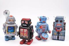 Vintage Toy Robots em um fundo branco Fotografia de Stock