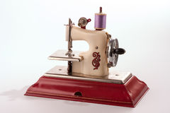 Vintage Toy Sewing Machine. A working toy sewing machine used by children probably to make clothes for their dolls Stock Photography