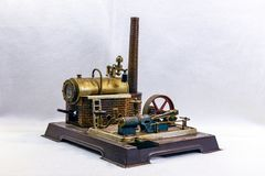 Toy steam engine factory on white background royalty free stock photos