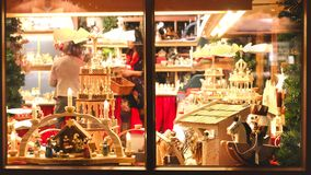 Vintage toy store window shop christmas market background. From outside royalty free stock image