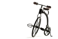Vintage toy velocipede isolated in white Stock Photos